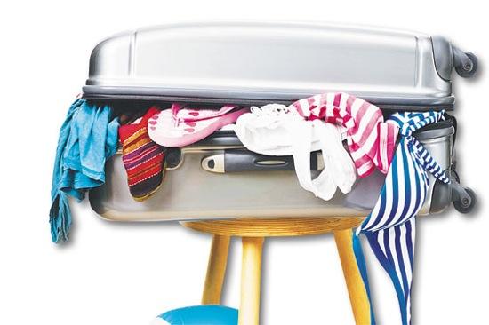 maleta llena vacaciones verano